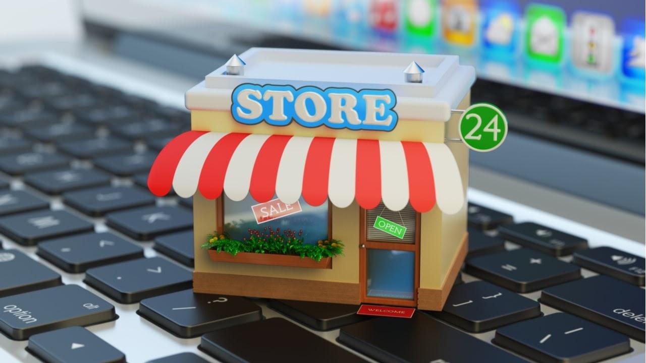 tienda de juguete encima de una laptop concepto de ecommerce
